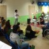 Participantes reunidos em uma sala
