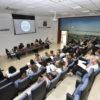 Integrantes participam de capacitação em auditório