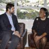 Prefeito conversa com embaixadora sentados em gabinete com Jundiaí ao fundo